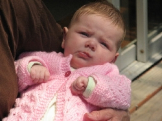 Baby with knitted woollen cardigan - no additives here. Photo Credit Elsie Hagley