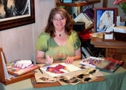 Mona MAjorowicz demonstrating technique at a gallery openhouse.