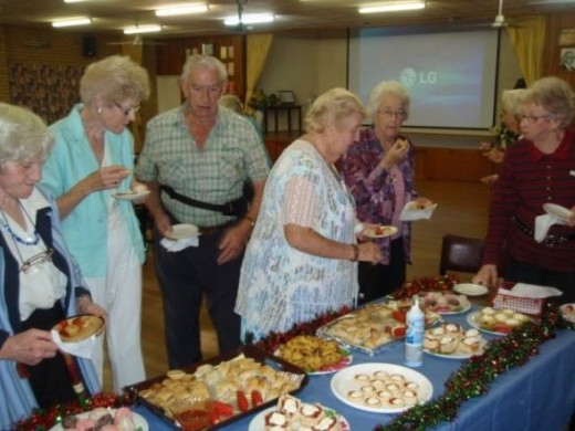 Serving up some munchies for an old time movie night for the Brisbane West Senior Citiziens.