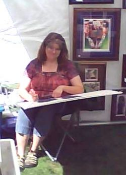 Mona Majorowicz Demonstrating Drawing Technique At An Art Event