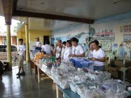 Macrine and I helping in the free distribution of drugs and medicines in the town of Mogpog