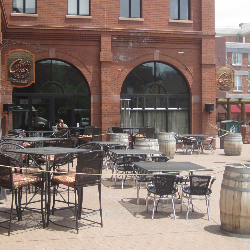 Patio seating for Cuvee 928 at Heritage Square