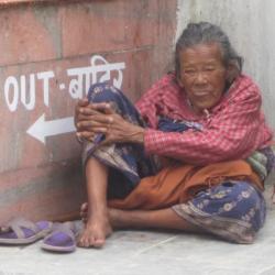 An elderly woman at Boudha Stupa in Kathmandu, Nepal