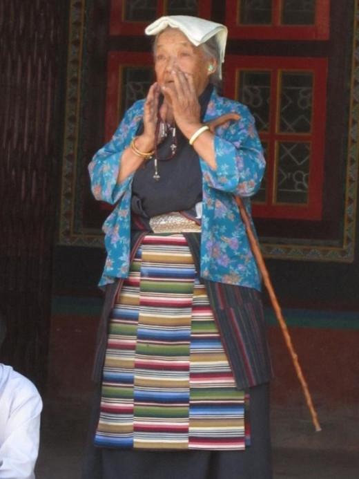 A woman at Boudha Stupa in Kathmandu