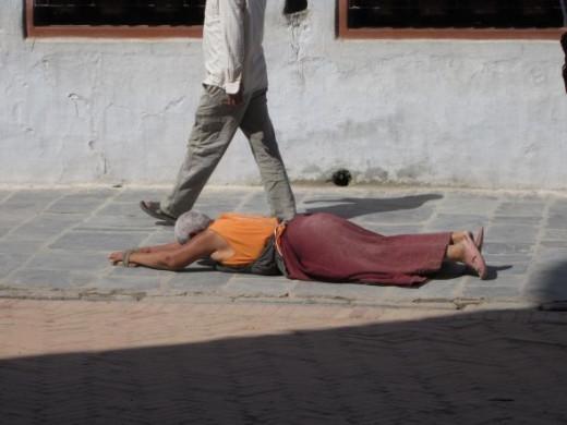 A man prays at Boudha Stupa