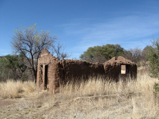 Remains of home in ghost town of Harshaw, Arizona.  Without regular maintenance and upkeep homes tend to crumble.
