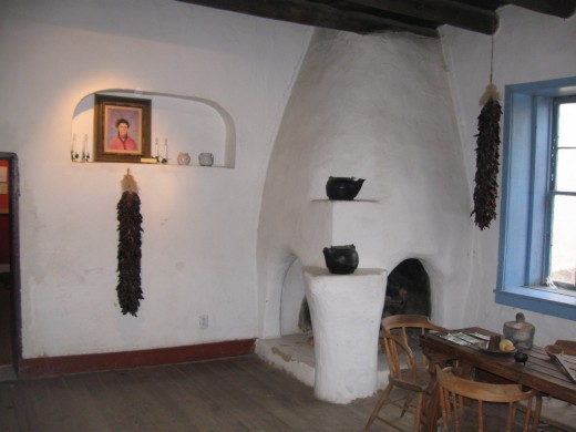 Dining area in Kit Carson's home in Taos, NM - furnishing a home in the past was simpler.