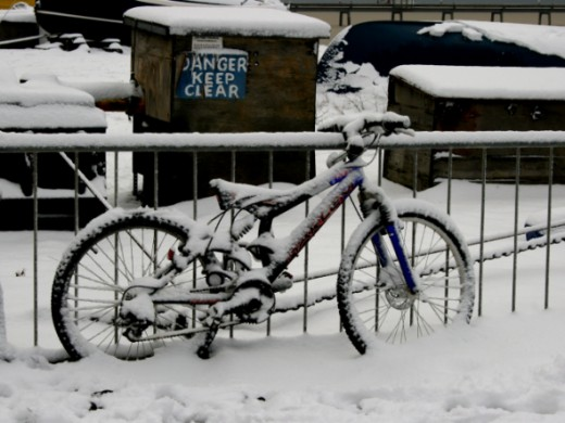 Bicycle covered in snow