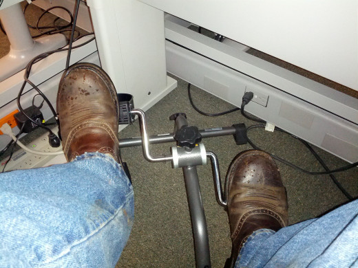 My husband pedaling at his desk