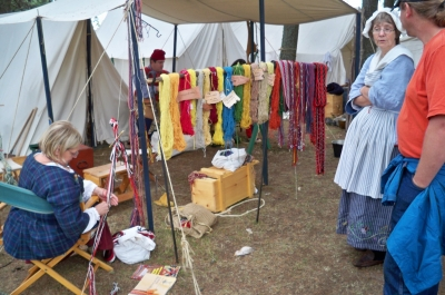 Natural dyes and weaving demonstrated in the encampment