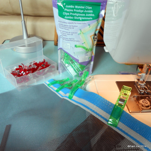 I'm using Clover Wonder Clips now when sewing window screen. They are terrific!