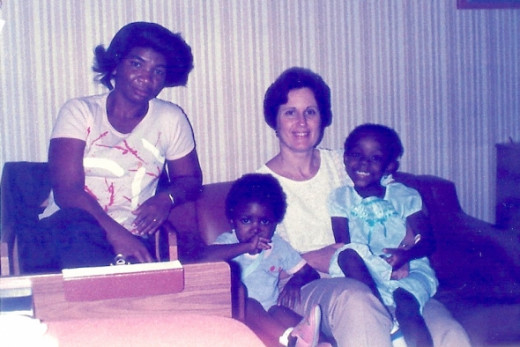 Here are my little friends, Keen-Ann and Alicia with Keen-Ann's mom and my mom.  I was taking the picture from my bed.