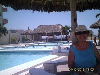 Mom by the pool in Mazatlan, Mexico