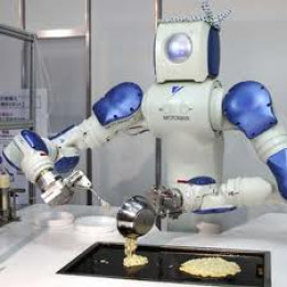 Robot in kitchen, cooking pancakes