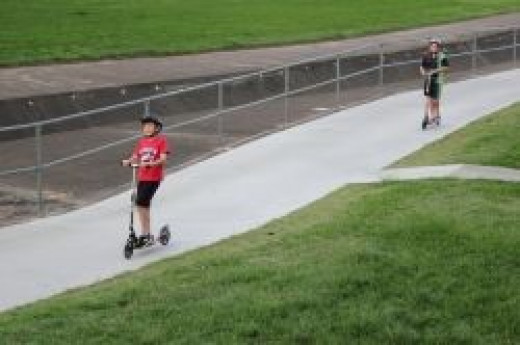 Kids on Scooters in Greenslopes Park