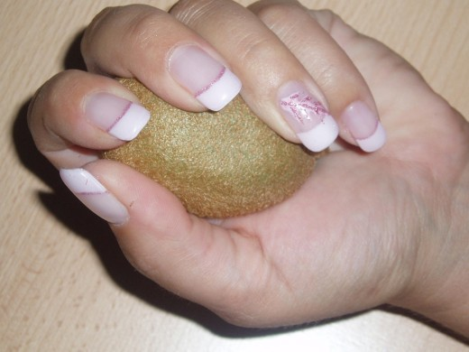 French manicure with pink glitter.
