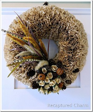Get directions for this coffee filter wreath.With about 200 coffee filters-brown or white, a glue gun and a wreath form, you can make this adorable wreath. Click on the picture to get directions