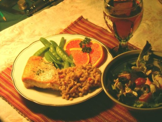 Salmon with barley pilaf, snow peas and oranges.