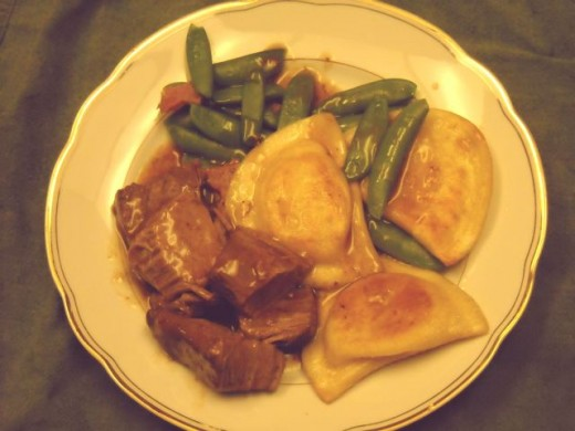 Pieroges and pot roast with fresh sugar snap peas.