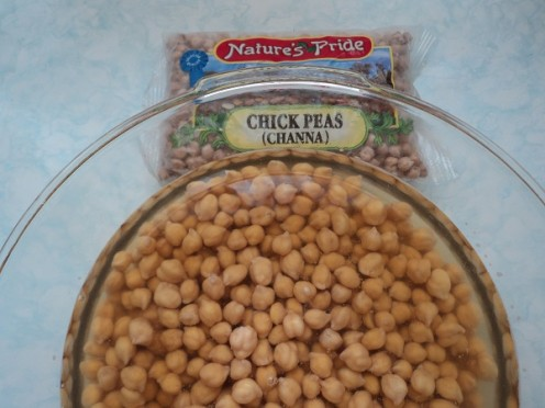 Raw (uncooked) Chick Peas or Channa soaking in water.