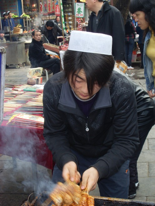 Muslim man cooking up a storm.