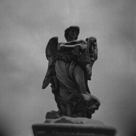 Angel with the Whips on Ponte Sant'Angelo in the snow from my very first black and white film in my Holga 120N