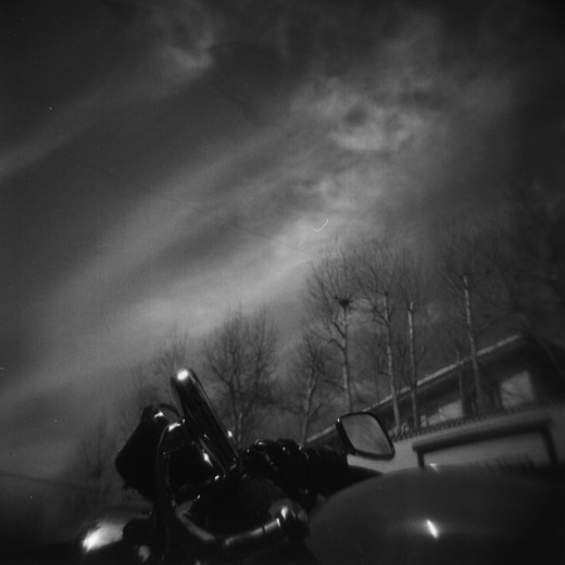 Shooting from the hip! A Harley-Davidson parked on Via Andria Doria, Rome. Using a red filter on my Holga 120N