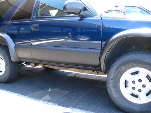 Here you see the spray coating on the rocker panels of this SUV.