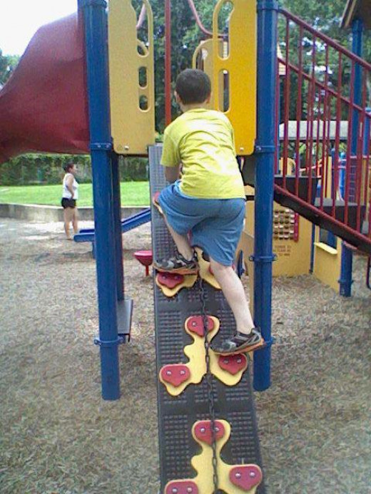 This is one of the things that my son tends to spend the most time on when we are at this playground. This photo was also sent off to his aunts.