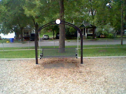 A swinging bench to watch the kids as they play.