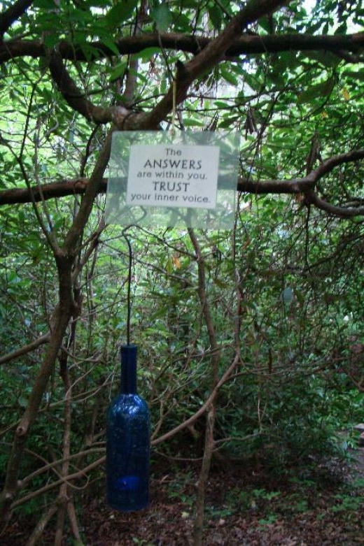 """We discovered a """"spiritual journey path"""" located on one of the trails. Every few feet, there would be a blue bottle along with a sign.  This sign says, """"The answers are within. Trust your inner voice."""""""