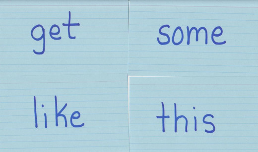 Place the words that your kids need to learn on flash cards. It helped me when I was a kid and it has helps my son now.