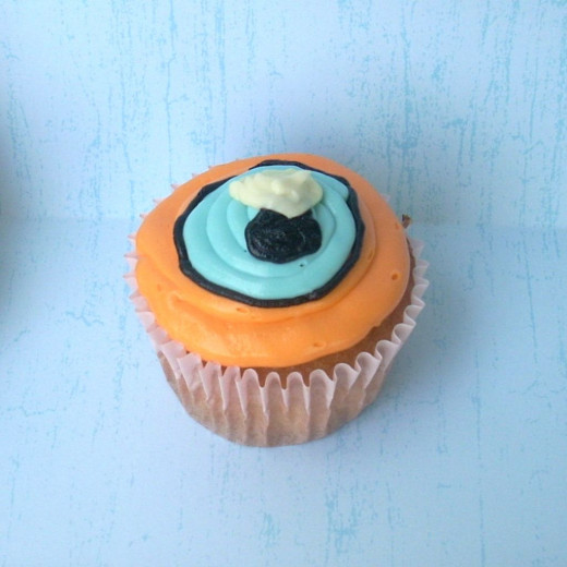 Squid eye cupcake with colored icings