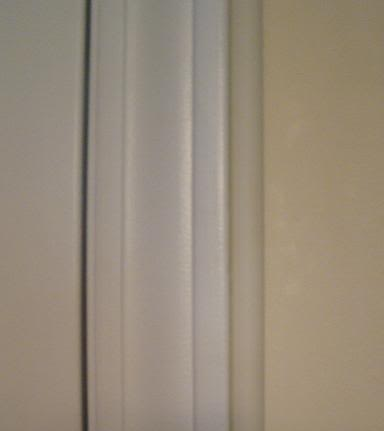 Casings along the side of the door to house electric wires.