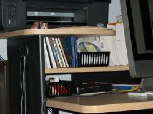 Storage shelves on computer desk for Mac