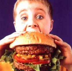 Child Eating A Hamburger