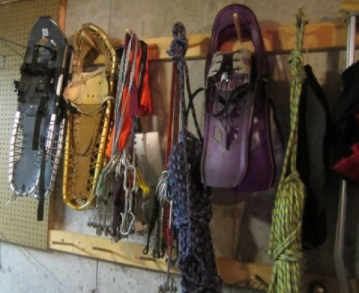 """This is our """"Winter Gear"""" wall... We had 2 more pair of snowshoes on this wall, but we sold 'em. :)"""