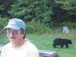 John in our yard with a bear meandering by... But that's another lens!