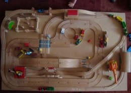 The finished train board. Someone is eager to play!