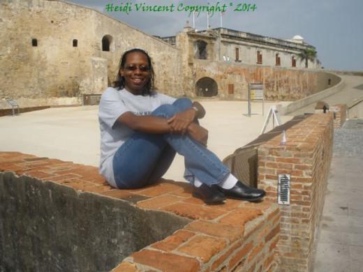 I'm posing on the wall outside Castillo San Cristobal :)