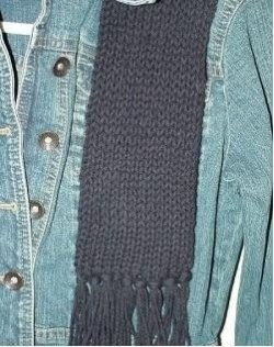 The black no wrap scarf in Peaches N Creme black worsted weight cotton yarn.