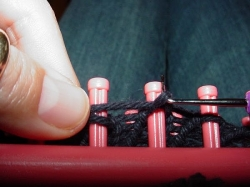 Knitting off on a loom