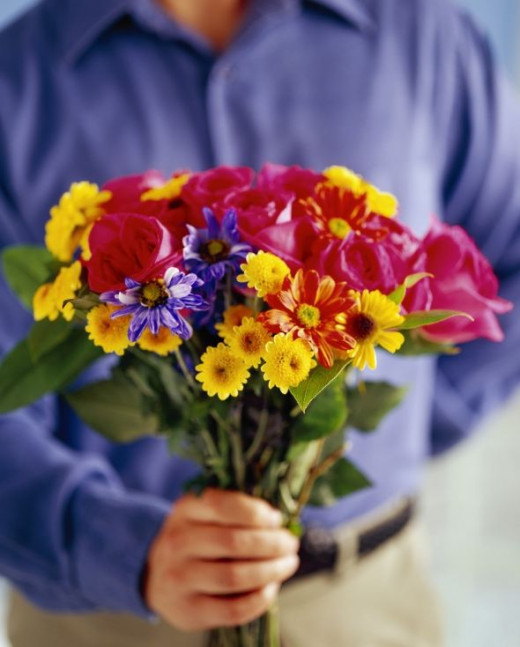 Man presenting flowers - Apologizing - Saying sorry