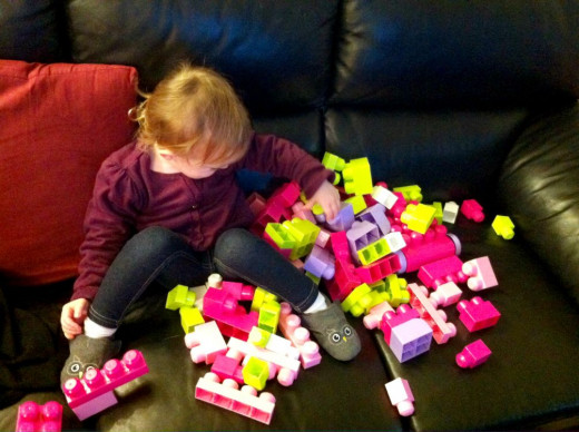 My daughter playing with her First Builders Mega Bloks for girls.