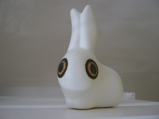 This little rabbit fits in the palm of my hand. My MIL had one and every time I visited her I would pick it up and rub it -- the porcelain is silky soft. She eventually bought me one. Ain't he sweet?