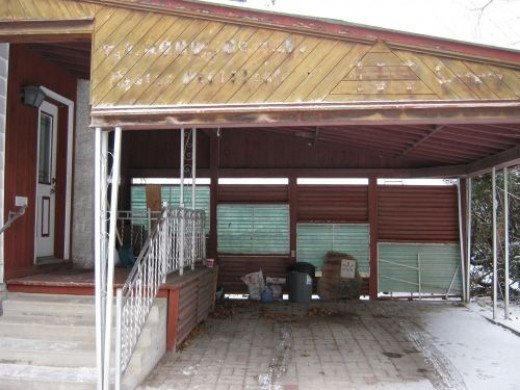 The carport. You can see where the name of the doctor's office used to be in the wood.