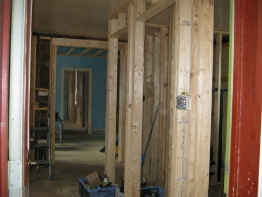 On entering the side door this is a view of the future closet and laundry room door.