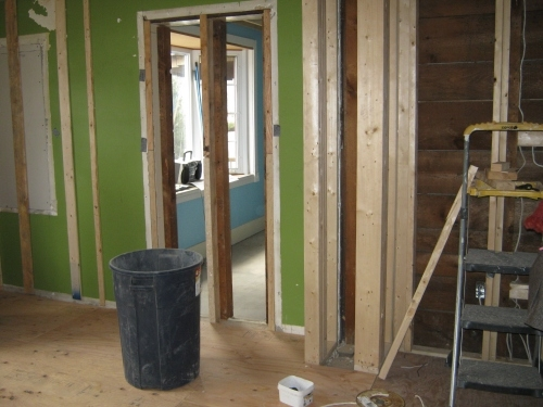 Here is a view into the old diningroom. The second doorway which led into the living room has been framed and will be covered with drywall. To the right is where the fridge will go.