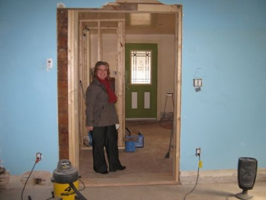 In the family room looking toward the now single entrance into the kitchen. Lana supervising.