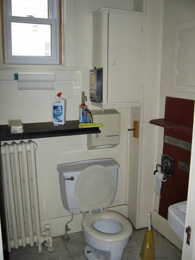 The toilet area and cabinet.